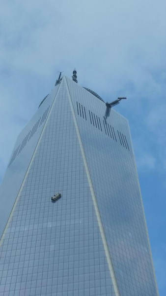 """<div class=""""meta image-caption""""><div class=""""origin-logo origin-image """"><span></span></div><span class=""""caption-text"""">Two workers became stuck on scaffolding hanging from 1 World Trade. (Photo courtesy: @bedopas)</span></div>"""