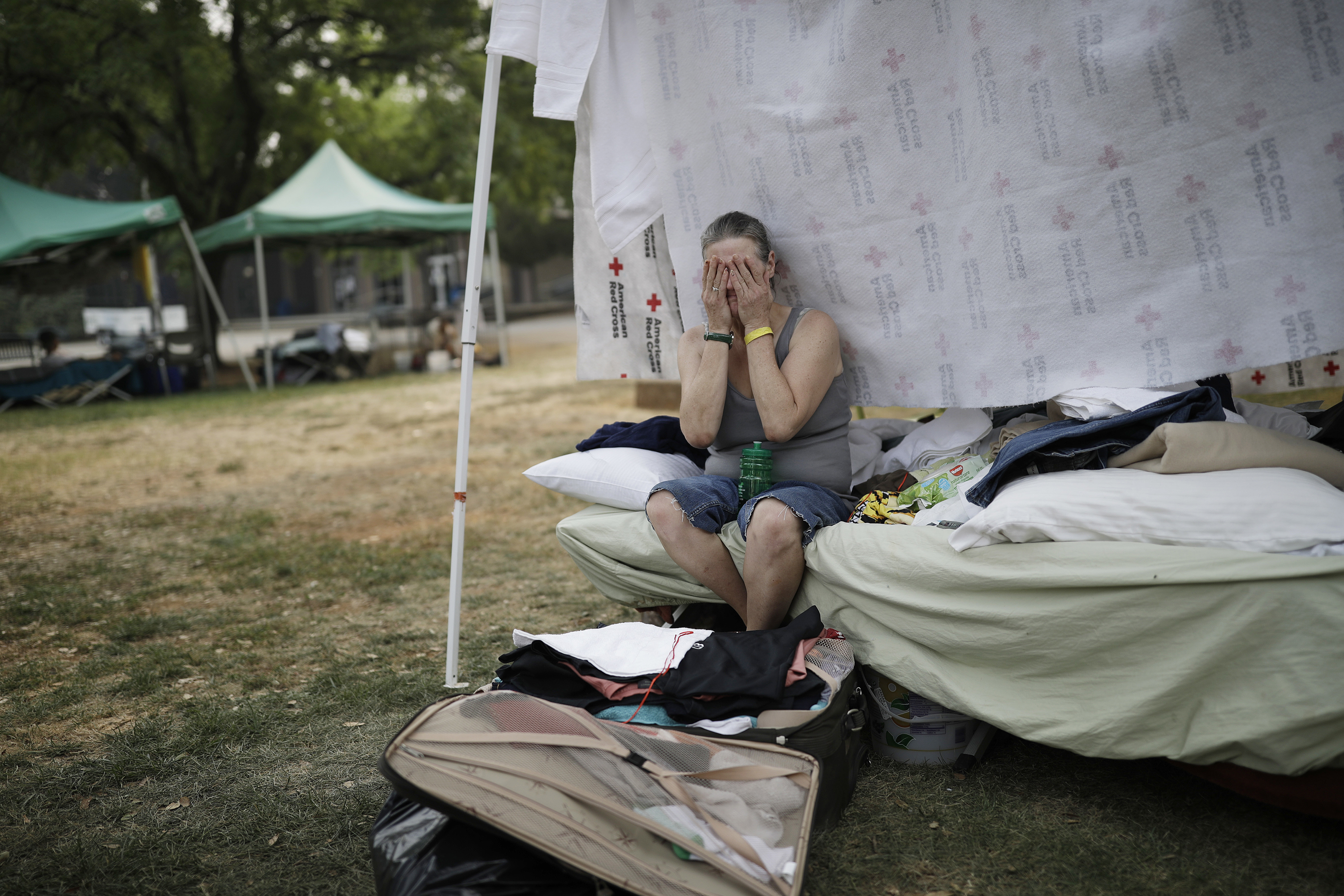 "<div class=""meta image-caption""><div class=""origin-logo origin-image none""><span>none</span></div><span class=""caption-text"">Starla Davis cries as she packs a suitcase in her makeshift tent at an evacuation center Aug. 9, 2018, in Redding, Calif. The evacuation center closes on Aug. 10. (John Locher/AP Photo)</span></div>"
