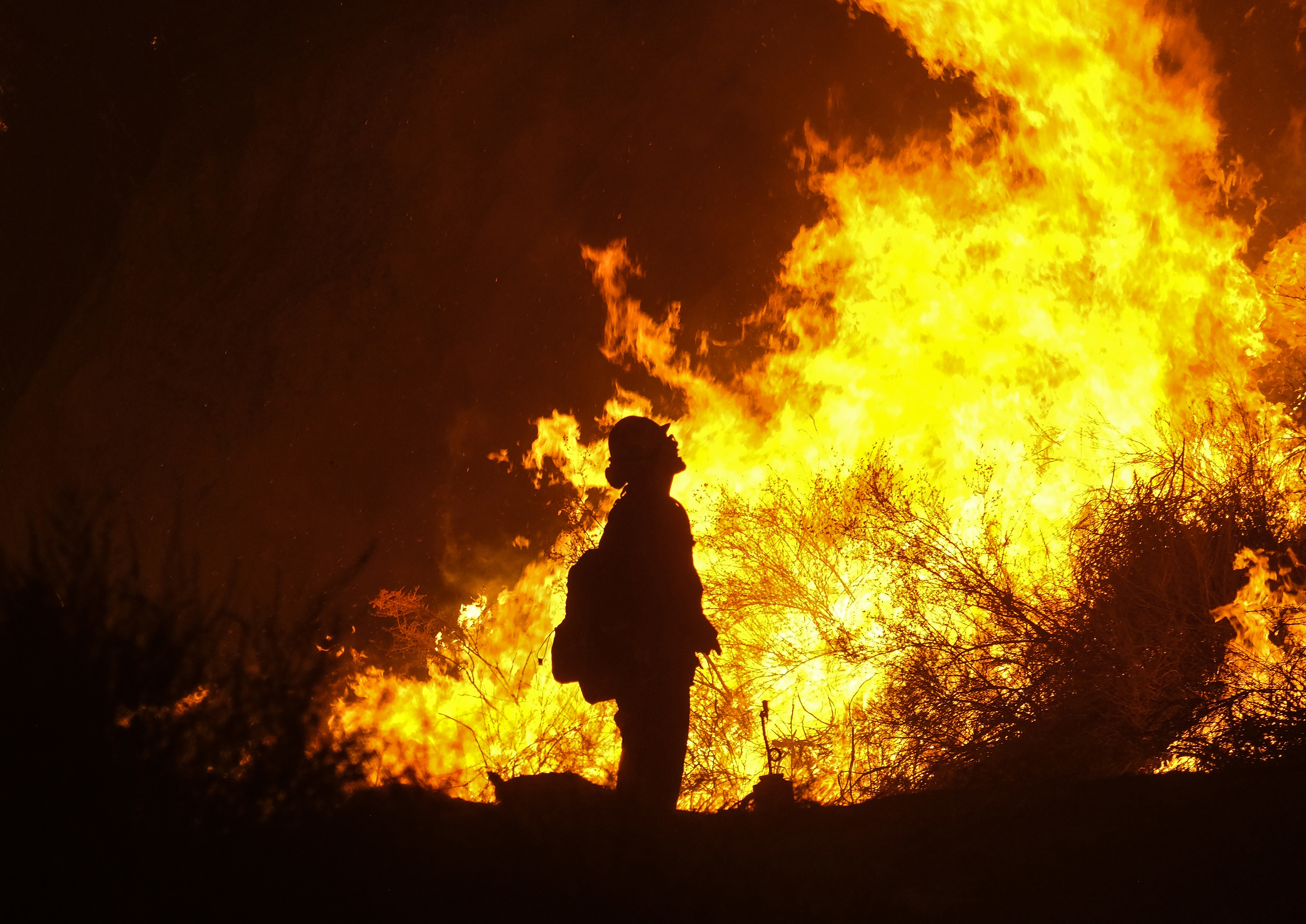 <div class='meta'><div class='origin-logo' data-origin='none'></div><span class='caption-text' data-credit='Ringo H.W. Chiu/AP Photo'>A firefighter keeps watch as the Holy Fire burns in the Cleveland National Forest along a hillside at Temescal Valley in Corona, Calif., Thursday, Aug. 9, 2018.</span></div>