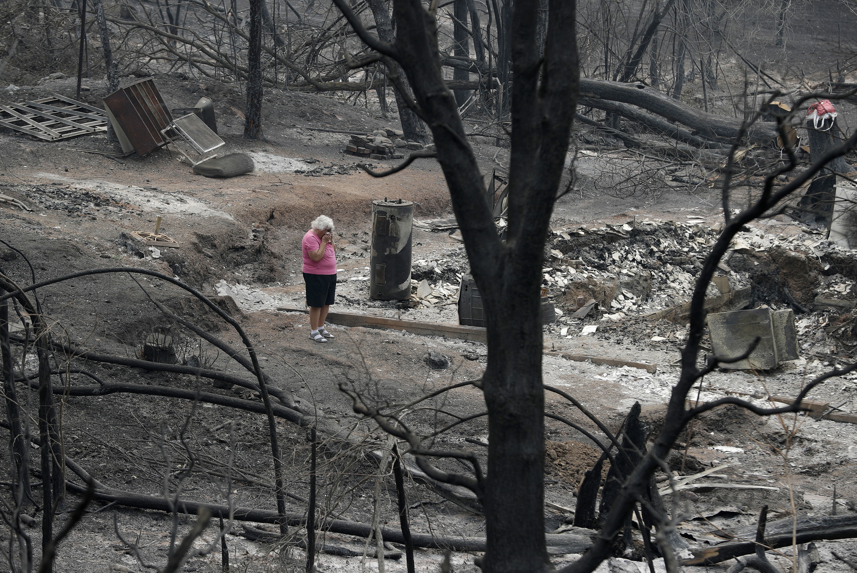 <div class='meta'><div class='origin-logo' data-origin='none'></div><span class='caption-text' data-credit='John Locher/AP Photo'>Loretta Root wipes her eyes while visiting the remains of her home in the Keswick area burned in the Carr Fire, Aug. 9, 2018, in Redding. &#34;It's hard to see this,&#34; Root said.</span></div>
