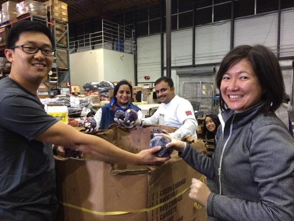 "<div class=""meta image-caption""><div class=""origin-logo origin-image ""><span></span></div><span class=""caption-text"">Black Rock employees volunteer at the San Francisco-Marin Food Bank.</span></div>"