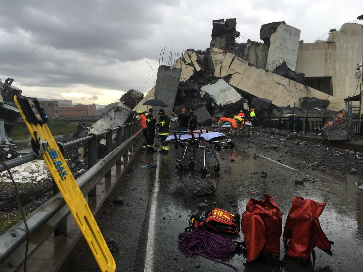 <div class='meta'><div class='origin-logo' data-origin='none'></div><span class='caption-text' data-credit='Matteo Pucciarelli via AP'>Cars are blocked on the Morandi highway bridge after a section of it collapsed, in Genoa, northern Italy, Tuesday, Aug. 14, 2018.</span></div>