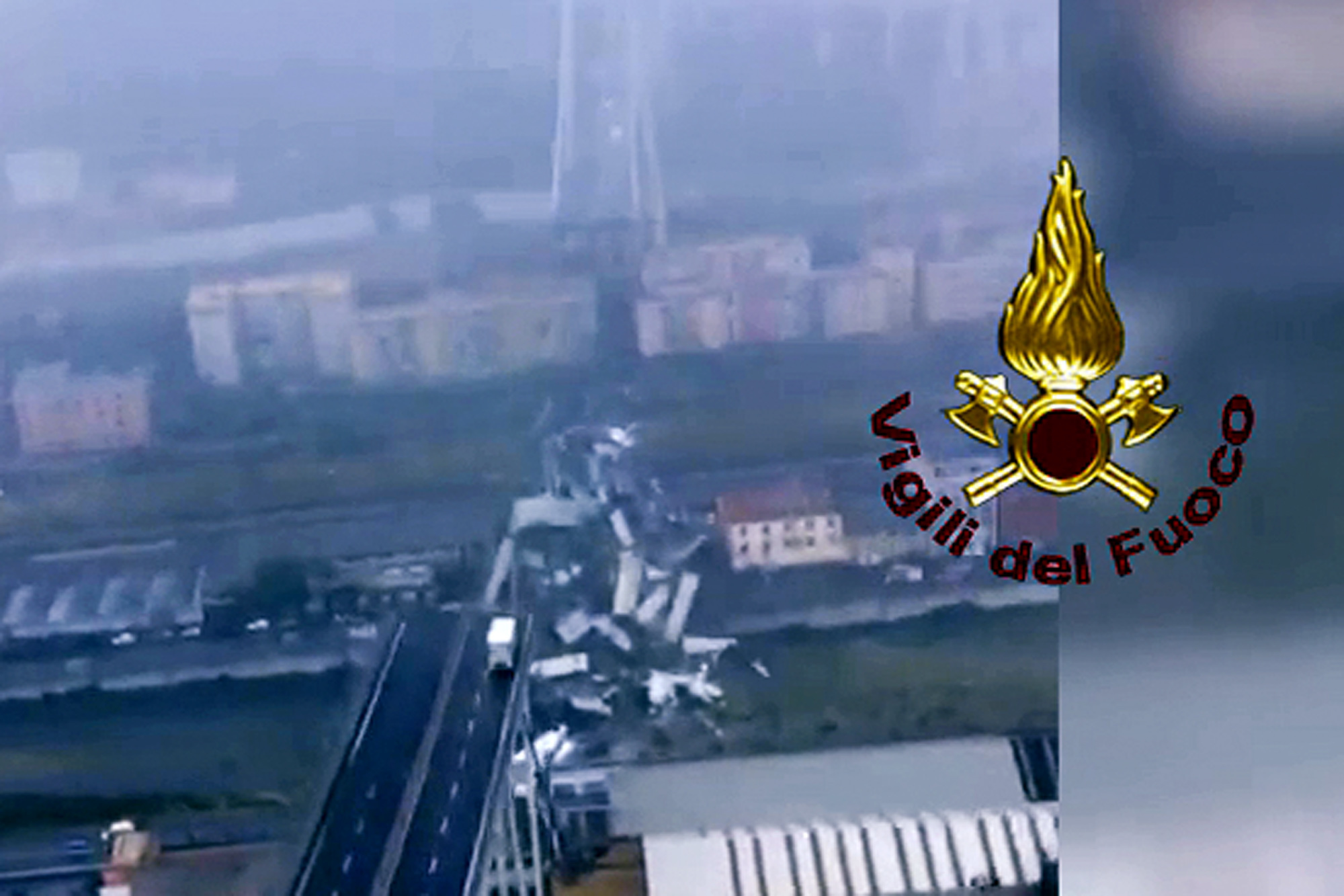 <div class='meta'><div class='origin-logo' data-origin='none'></div><span class='caption-text' data-credit='Vigili Del Fuoco via AP'>This frame taken from a video released by the Italian firefighters, shows an aerial view of the collapsed Morandi highway bridge in Genoa, northern Italy, Tuesday, Aug. 14, 2018.</span></div>