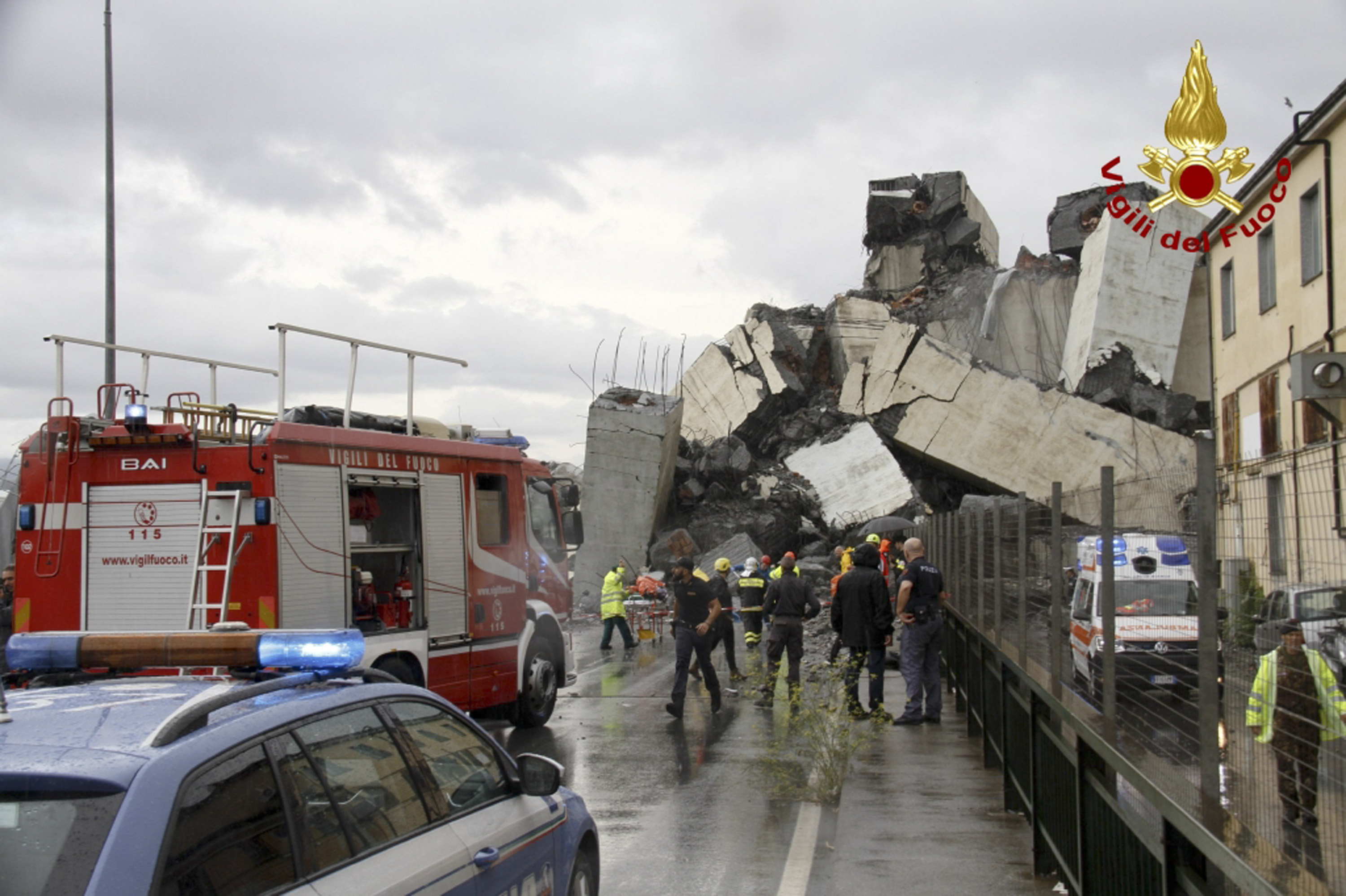 <div class='meta'><div class='origin-logo' data-origin='none'></div><span class='caption-text' data-credit='Vigili Del Fuoco via AP'>This photo released by the Italian firefighters, rescuers work among the rubble of the collapsed Morandi highway bridge in Genoa, northern Italy, Tuesday, Aug. 14, 2018.</span></div>