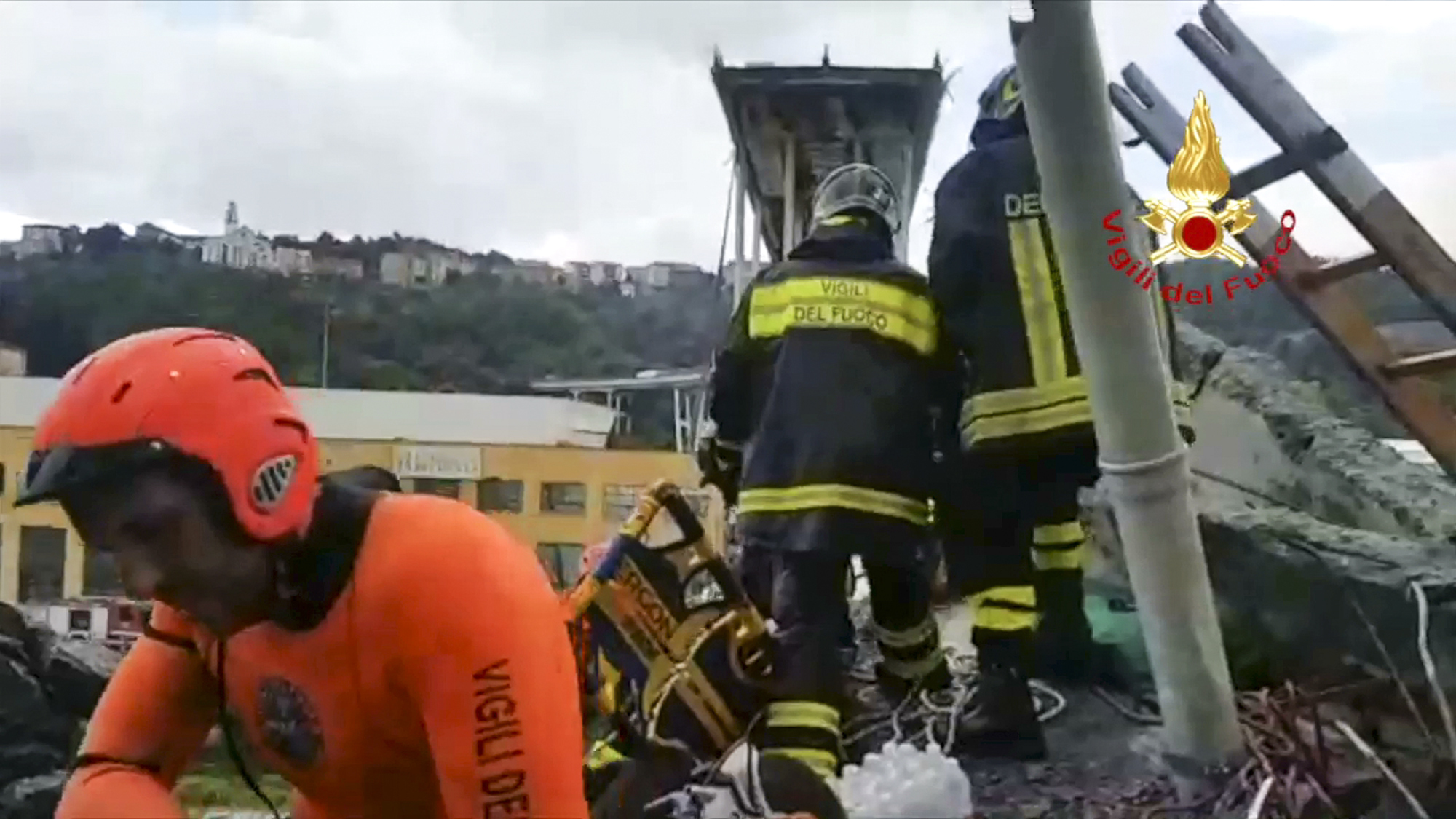 <div class='meta'><div class='origin-logo' data-origin='none'></div><span class='caption-text' data-credit='Vigili Del Fuoco via AP'>This frame taken from a video released by the Italian firefighters, shows firefighters working on the site of the collapsed Morandi highway bridge in Genoa, northern Italy.</span></div>