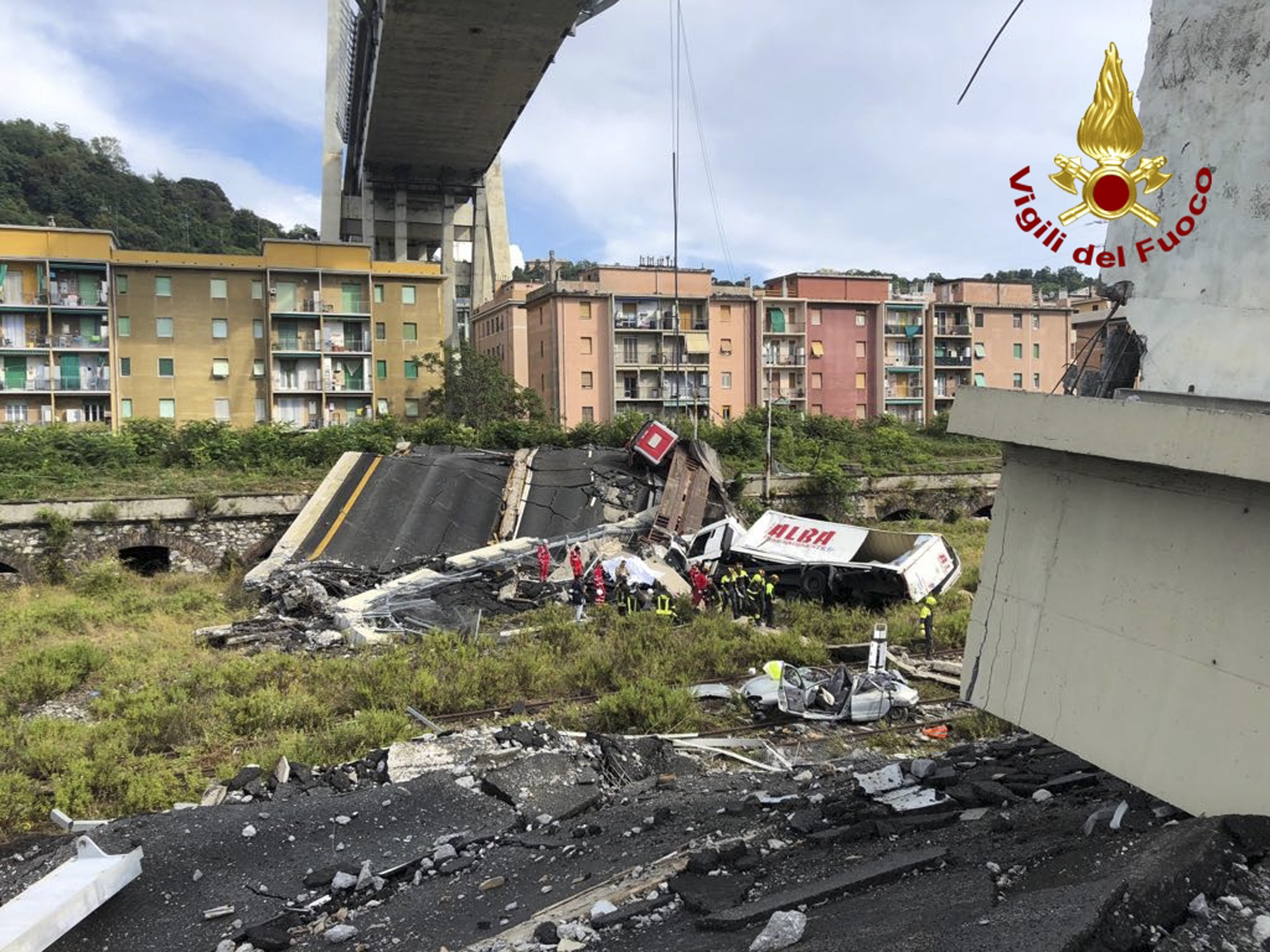 <div class='meta'><div class='origin-logo' data-origin='none'></div><span class='caption-text' data-credit='Vigili Del Fuoco via AP'>In this photo released by the Italian firefighters, rescue teams work among the rubble of the collapsed Morandi highway bridge in Genoa, northern Italy, Tuesday, Aug. 14, 2018.</span></div>