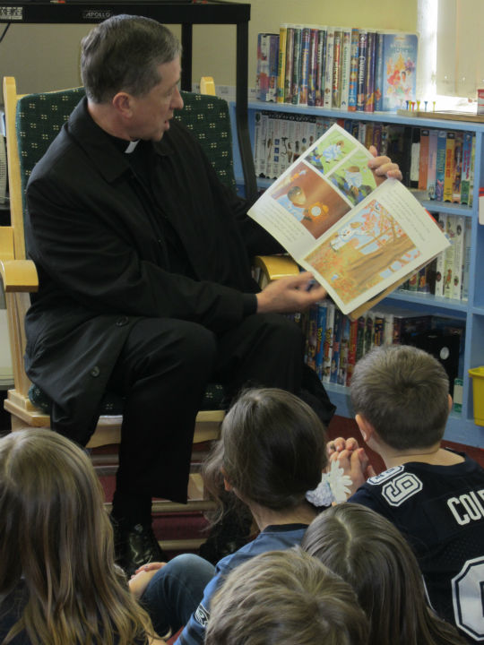 "<div class=""meta image-caption""><div class=""origin-logo origin-image ""><span></span></div><span class=""caption-text"">Bishop Blase Cupich reading to students at Trinity School, Spokane, during Catholic Schools Week 2012 (WLS Photo)</span></div>"