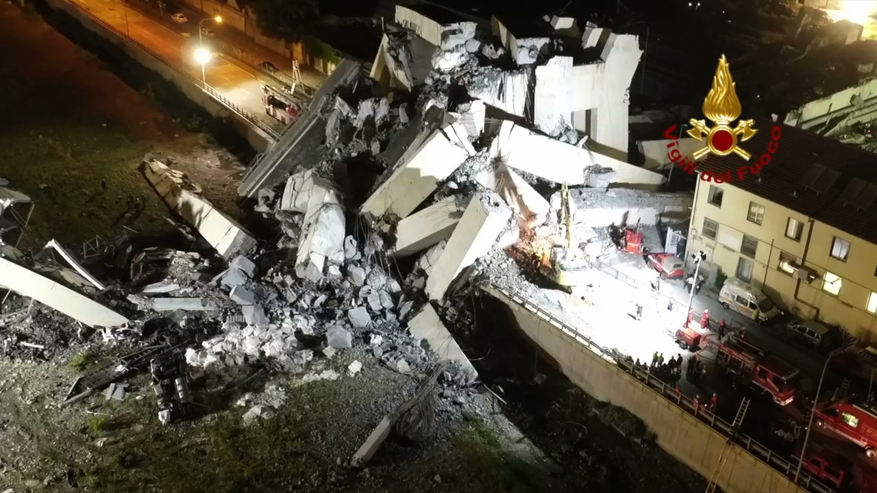 <div class='meta'><div class='origin-logo' data-origin='none'></div><span class='caption-text' data-credit='Vigili Del Fuoco via AP'>In this frame taken from a video released by the Italian firefighters, rescue teams work among the rubble of the collapsed Morandi highway bridge on Wednesday, Aug. 15, 2018.</span></div>