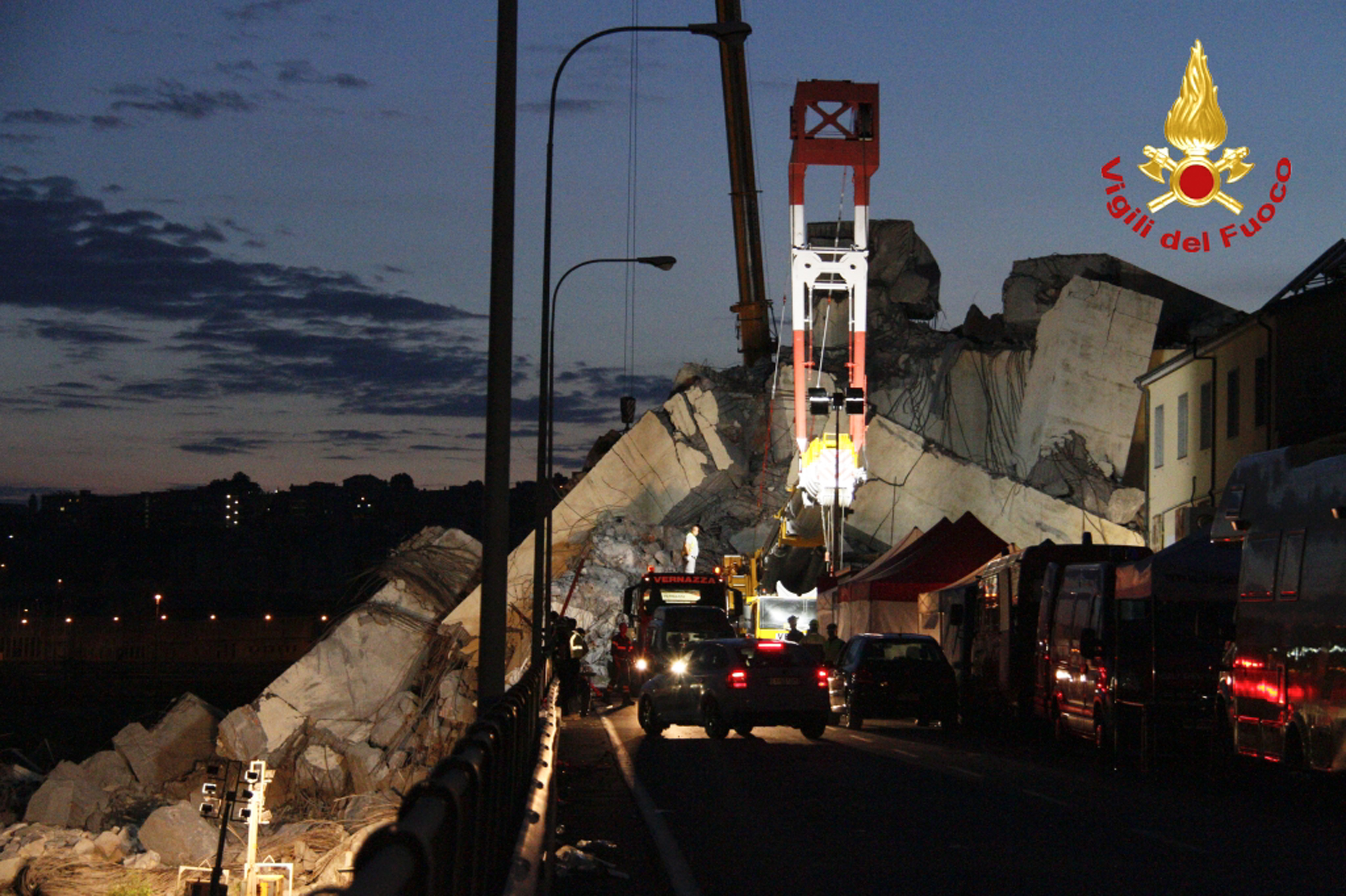 <div class='meta'><div class='origin-logo' data-origin='none'></div><span class='caption-text' data-credit='Vigili Del Fuoco via AP'>In this photo released by the Italian firefighters, rescue teams work among the rubble of the collapsed Morandi highway bridge in Genoa, northern Italy, Wednesday, Aug. 15, 2018.</span></div>