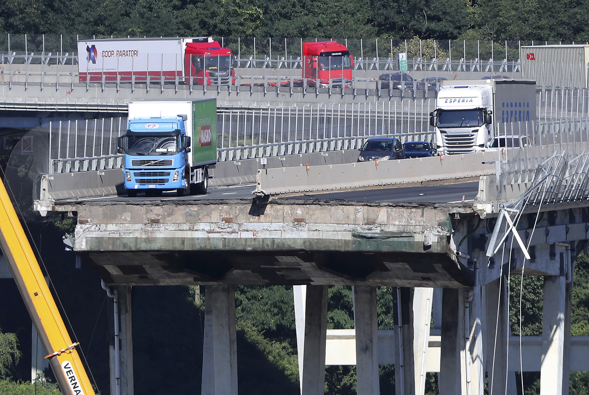 <div class='meta'><div class='origin-logo' data-origin='none'></div><span class='caption-text' data-credit='Antonio Calanni/AP Photo'>A view of the Morandi highway bridge that collapsed in Genoa, northern Italy, Wednesday, Aug. 15, 2018.</span></div>