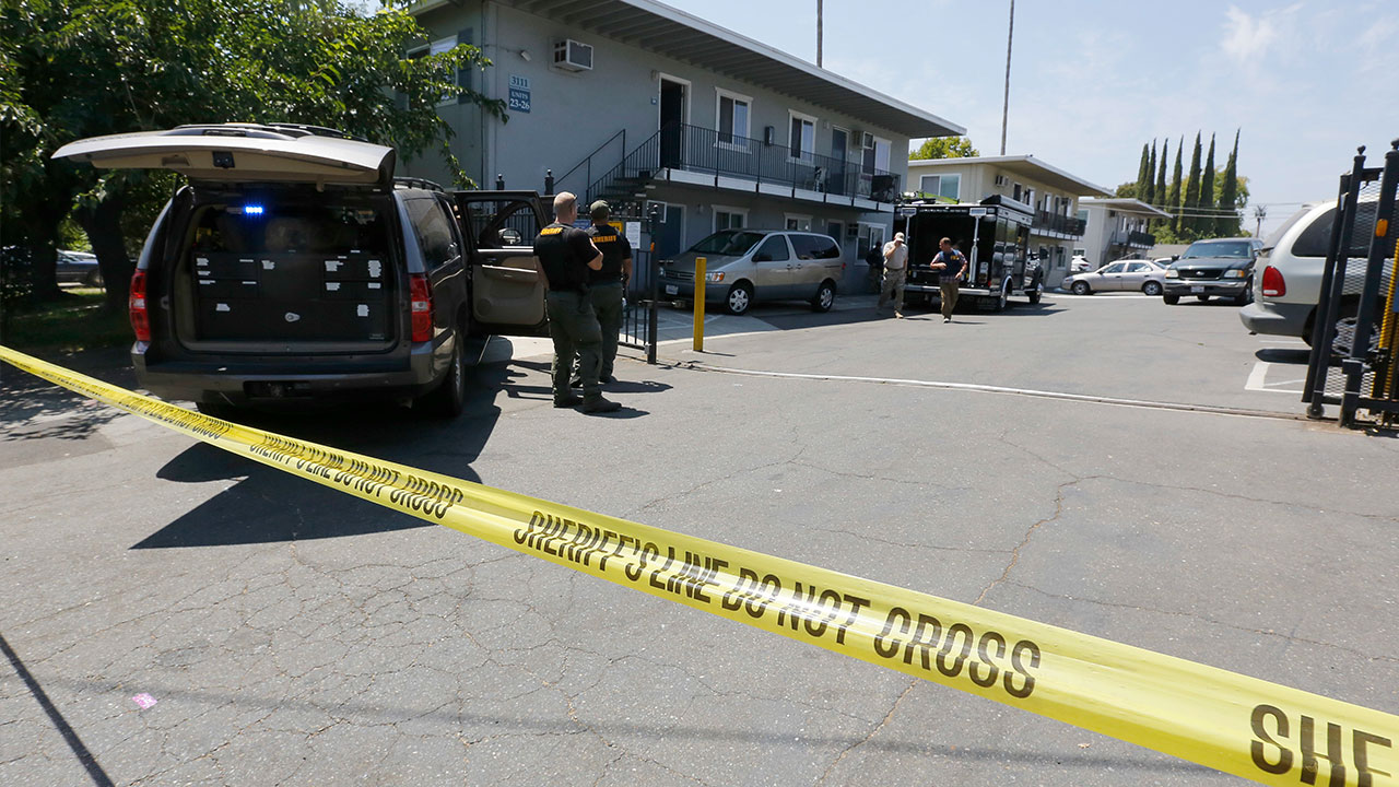 <div class='meta'><div class='origin-logo' data-origin='none'></div><span class='caption-text' data-credit='AP Photo/Rich Pedroncelli'>Crime scene tape blocks the entrance to an apartment complex following the arrest of a 45-year-old Iraqi refugee, Omar Ameen.</span></div>