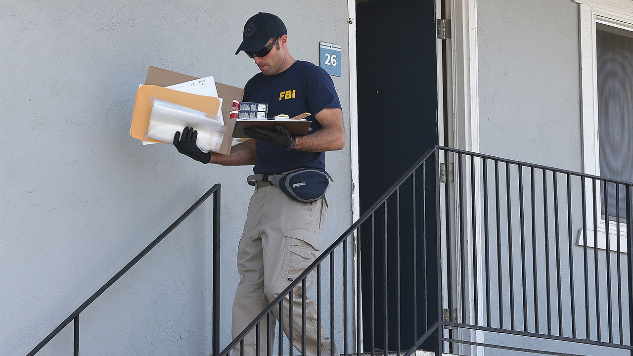 <div class='meta'><div class='origin-logo' data-origin='none'></div><span class='caption-text' data-credit='AP Photo/Rich Pedroncelli'>A federal agent removes items from an apartment following the arrest of a 45-year-old Iraqi refugee, Omar Ameen, Wednesday, in Sacramento.</span></div>