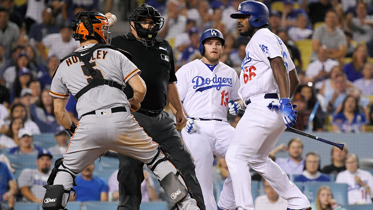 A shoving match between the Dodgers' Yasiel Puig (right) and Giants catcher Nick Hundley escalated into a bench-clearing brawl on Aug. 14, 2018 at Dodger Stadium.