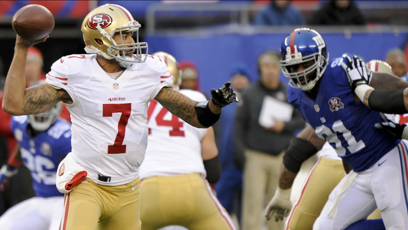 San Francisco 49ers quarterback Colin Kaepernick (7) throws a pass during a football game against the New York Giants Nov. 16, 2014, in East Rutherford, N.J. (AP Photo/Bill Kostroun)