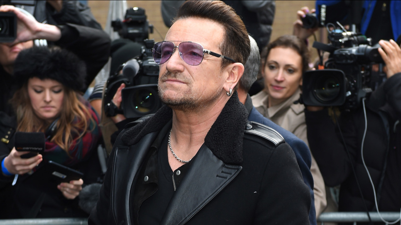 Singer Bono arrives at a music studio to record his segment of the new Band Aid 30 charity single in London, Saturday, Nov. 15 2014.