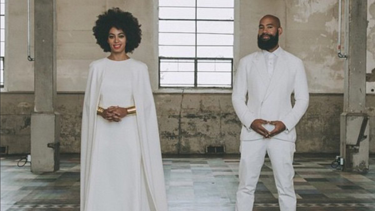 Solange Knowles and her new husband, 51-year-old video director Alan Ferguson, pose for a photo at their wedding over the weekend.