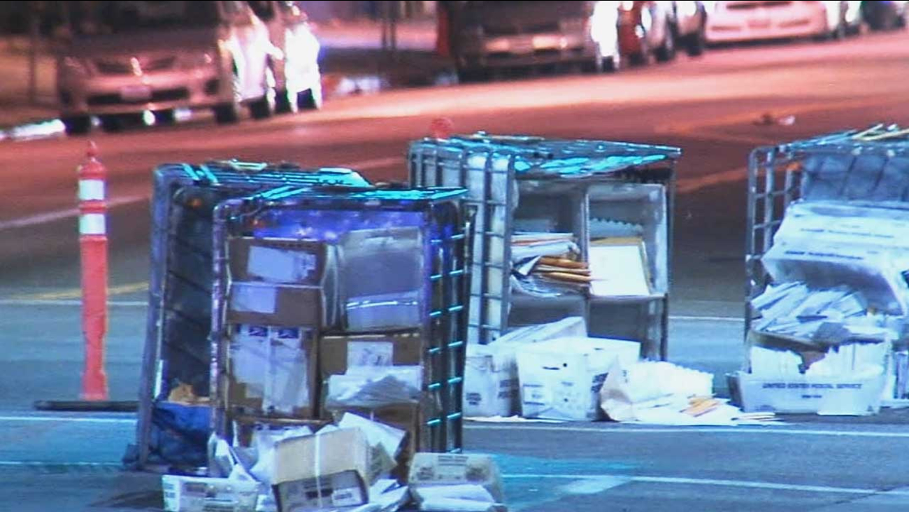 Postal truck loses crates of mail on Hollywood street | abc7 com