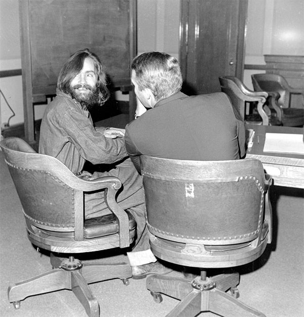 <div class='meta'><div class='origin-logo' data-origin='none'></div><span class='caption-text' data-credit='Photo/AP'>Cult leader Charles Manson looks back and smiles as his attorney, public defender Fred Schaefer, talks to him in Independence, Calif., on Dec. 4, 1969.</span></div>