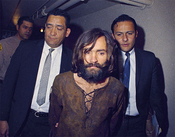 "<div class=""meta image-caption""><div class=""origin-logo origin-image none""><span>none</span></div><span class=""caption-text"">Charles Manson is escorted to his arraignment on conspiracy-murder charges in conneciton with the Sharon Tate murder case, 1969, Los Angeles, Calif. (Photo/AP)</span></div>"