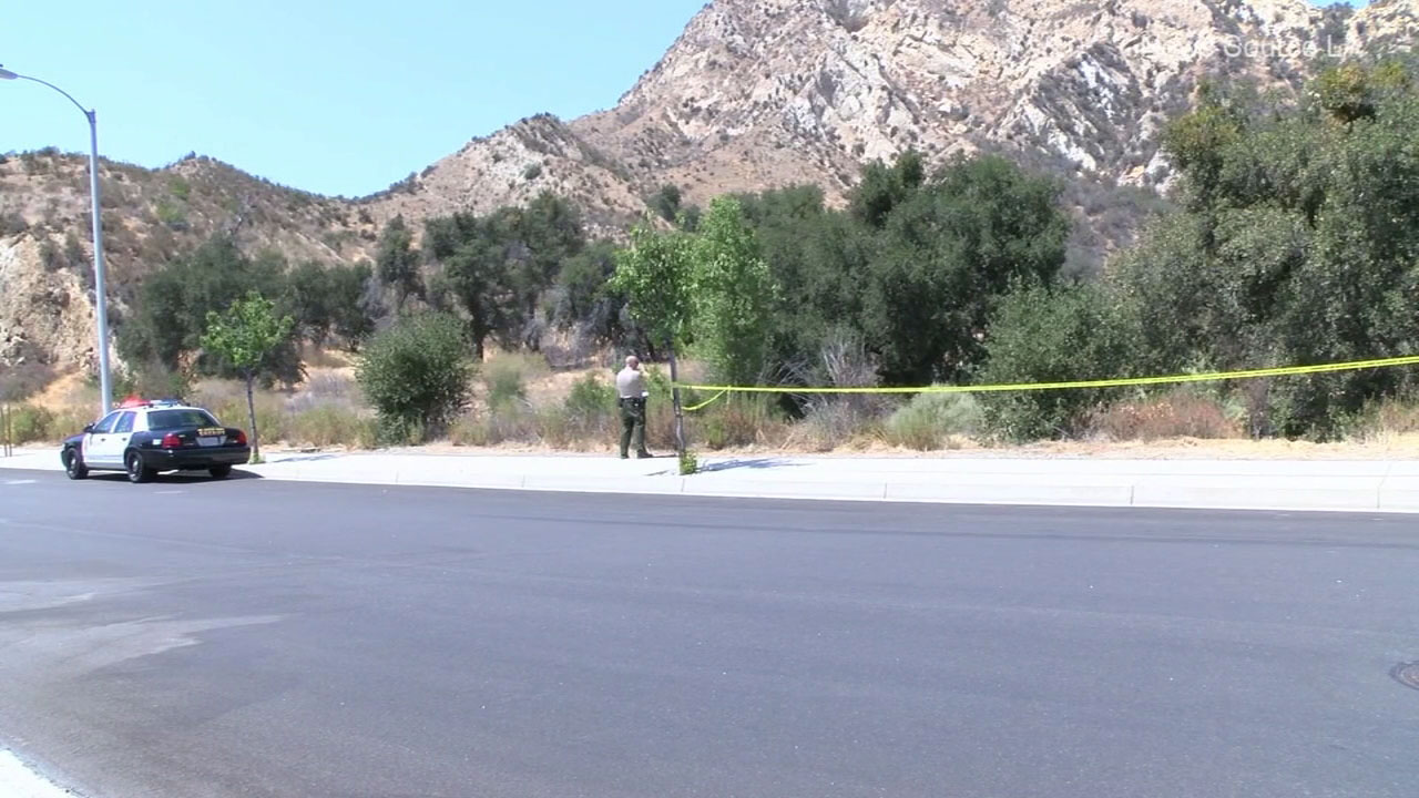 Authorities blocked off an area where a body was found hanging near a tree in a possible suicide in Stevenson Ranch.