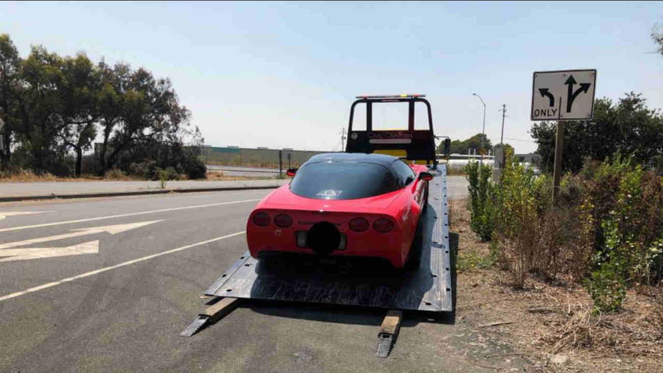 A car is seen being impounded after the driver was arrested for alleged street-racing in Richmond, Calif. on Sunday, August 19, 2018.