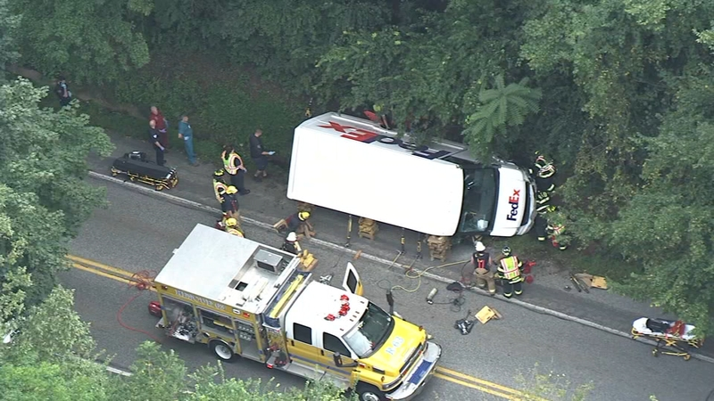 FedEx truck rolls over after crash in Chester Co