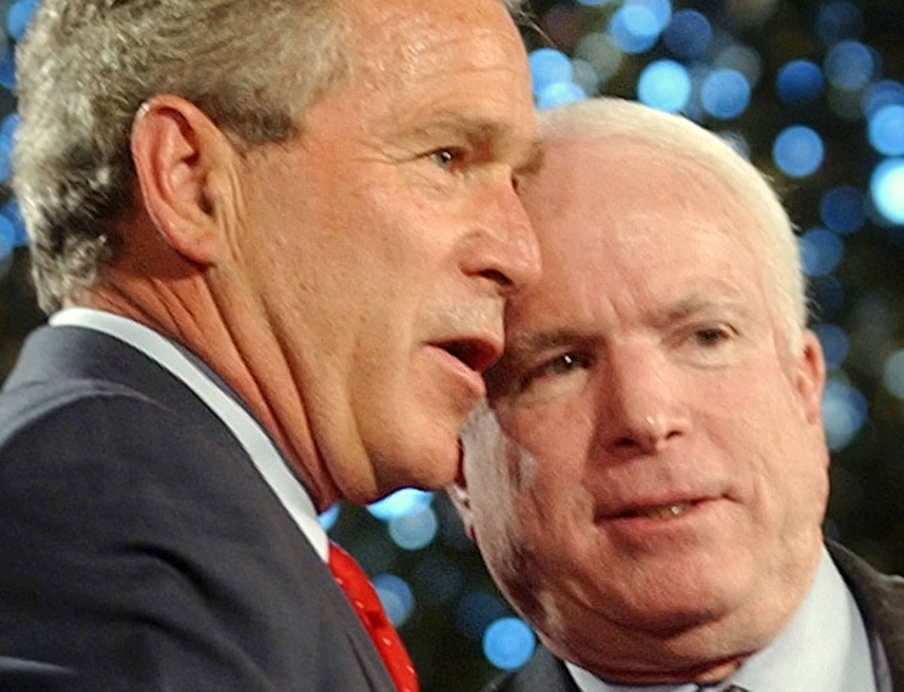 <div class='meta'><div class='origin-logo' data-origin='AP'></div><span class='caption-text' data-credit='AP Photo/Susan Walsh'>President Bush and Sen. John McCain, R-Az., right, share a word while on stage before addressing the troops at Fort Lewis, Wash., Friday, June 18, 2004.</span></div>