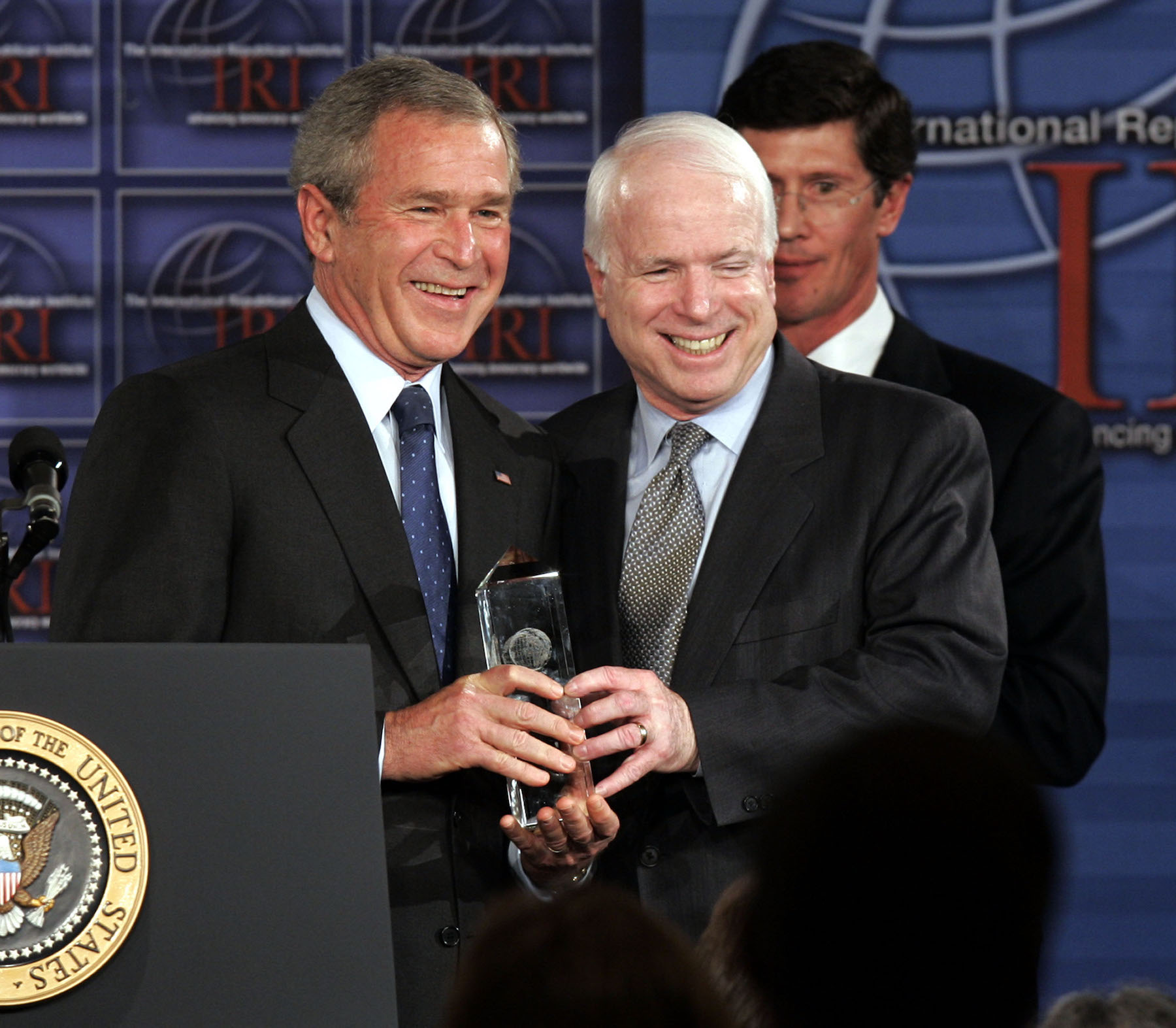 <div class='meta'><div class='origin-logo' data-origin='AP'></div><span class='caption-text' data-credit='AP Photo/Charles Dharapak'>President Bush is presented with the International Republican Institute's Freedom Award by Sen. John McCain at the IRI Freedom Dinner in Washington in 2005.</span></div>