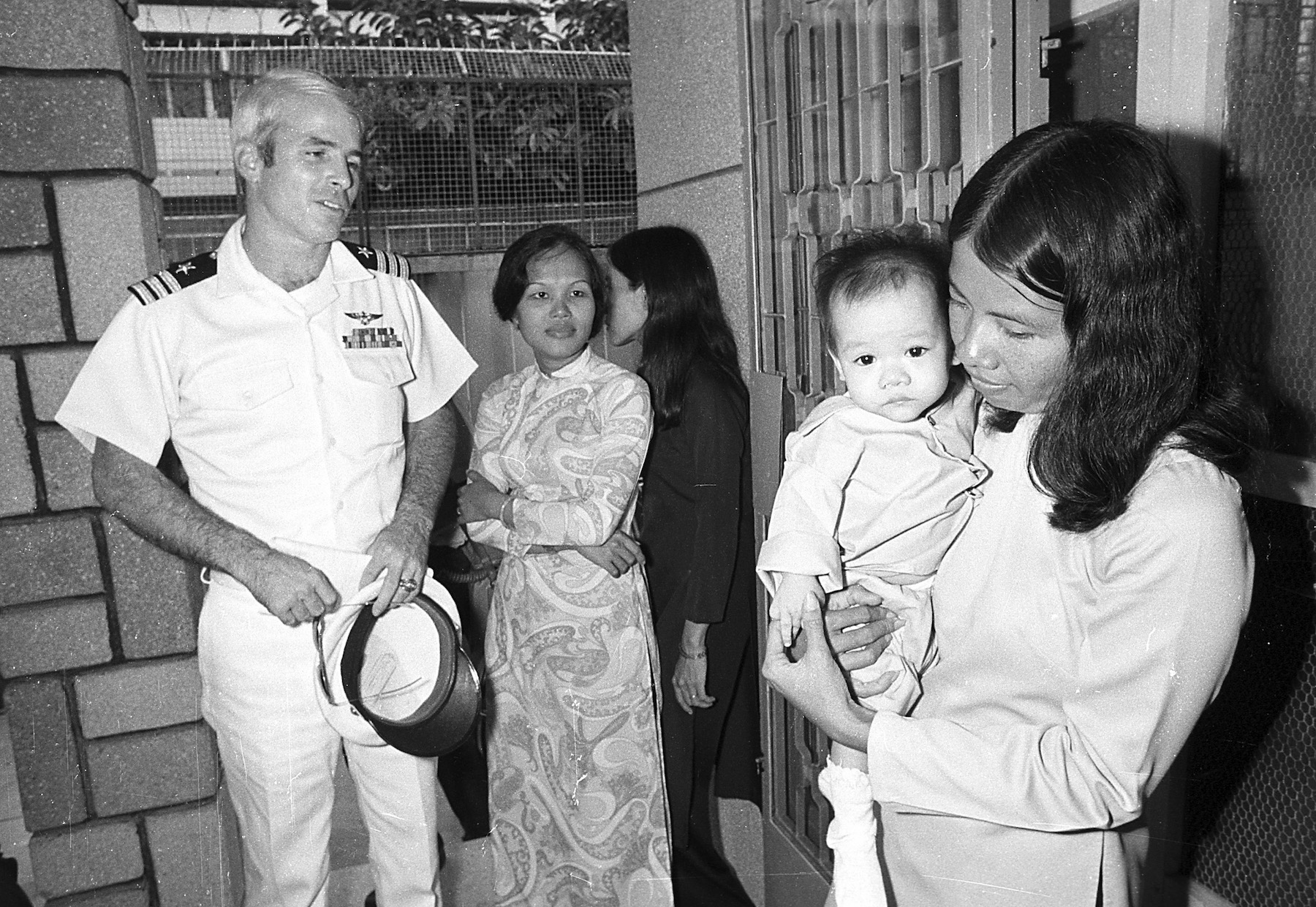 <div class='meta'><div class='origin-logo' data-origin='AP'></div><span class='caption-text' data-credit='AP Photo/Dang Van Phuoc'>U.S. Navy Commander John S. McCain, a guest of the South Vietnamese government, visits the Holt orphanage in Saigon, Vietnam, on Oct. 30, 1974.</span></div>