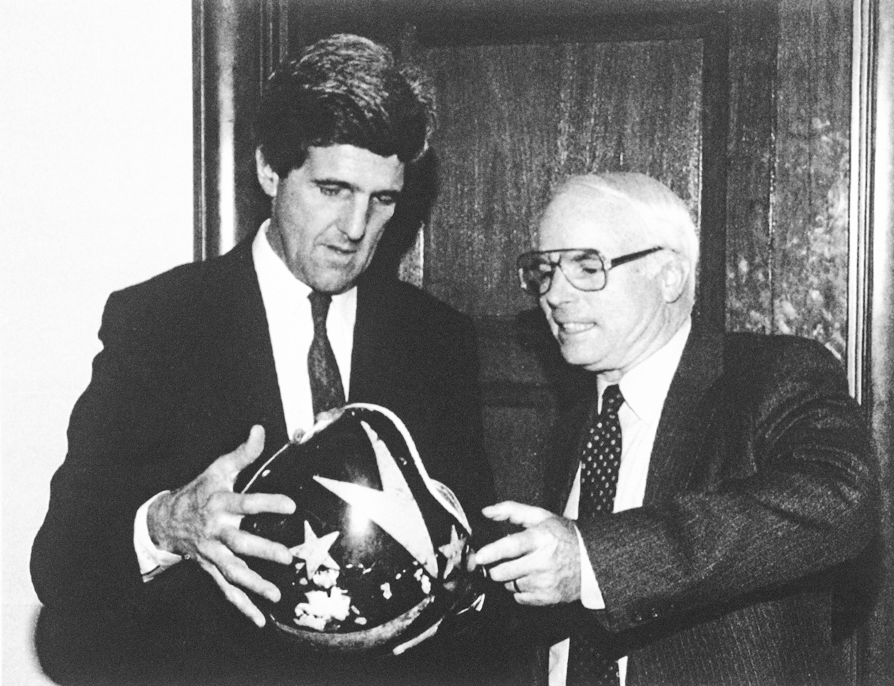 <div class='meta'><div class='origin-logo' data-origin='AP'></div><span class='caption-text' data-credit='AP Photo/U.S. Senate'>Sen. John Kerry gives Sen. John McCain his pilot's helmet on Capitol Hill in Washington, Dec. 2, 1992.</span></div>