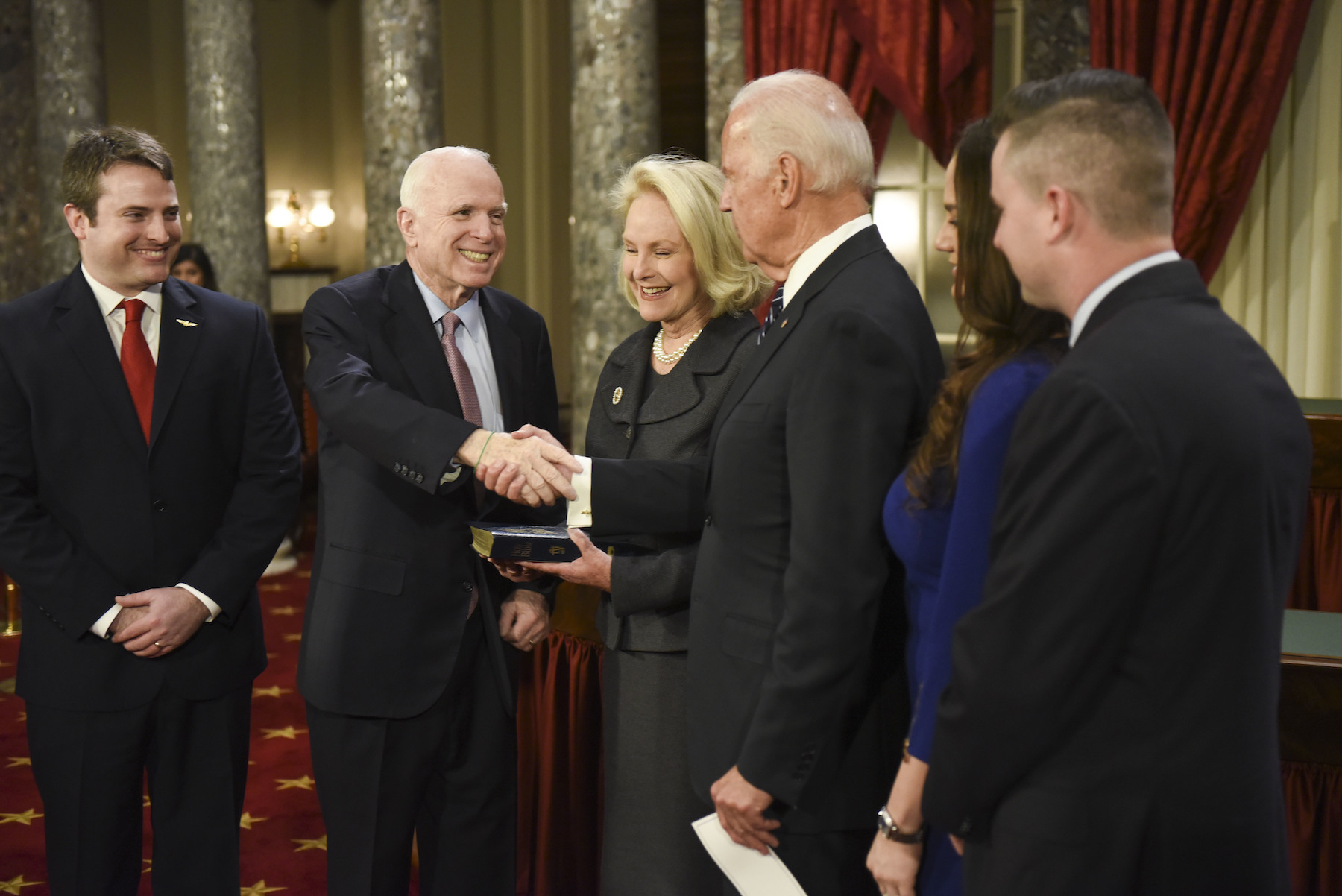 <div class='meta'><div class='origin-logo' data-origin='AP'></div><span class='caption-text' data-credit='AP Photo/Kevin Wolf'>Vice President Joe Biden shakes hands with Sen. John McCain after administering the Senate oath of office during a mock swearing-in ceremony on Tuesday, Jan. 3, 2017.</span></div>