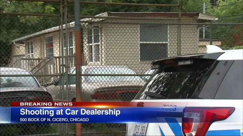 Man shot at West Side car dealership