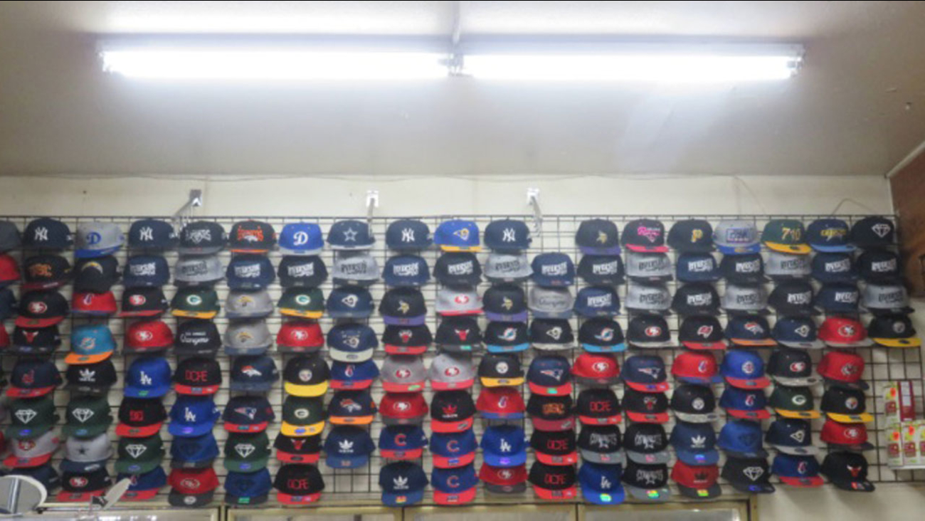 Counterfeit sports hats are shown in a photo provided by Riverside police.