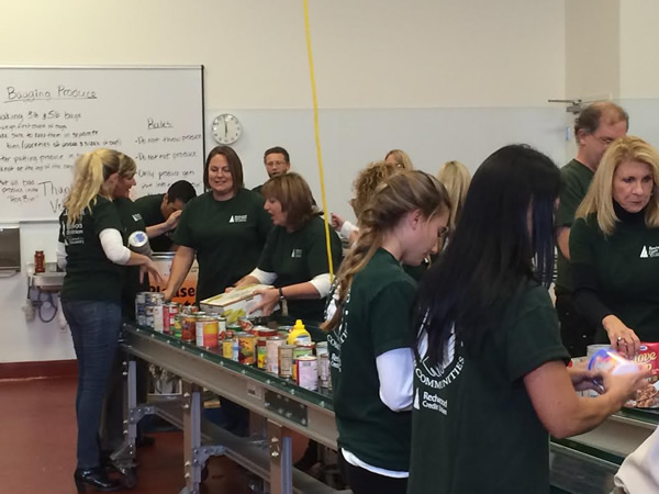 "<div class=""meta image-caption""><div class=""origin-logo origin-image ""><span></span></div><span class=""caption-text"">Redwood Credit Union employees volunteer at the Redwood Empire Food Bank in Santa Rosa.</span></div>"