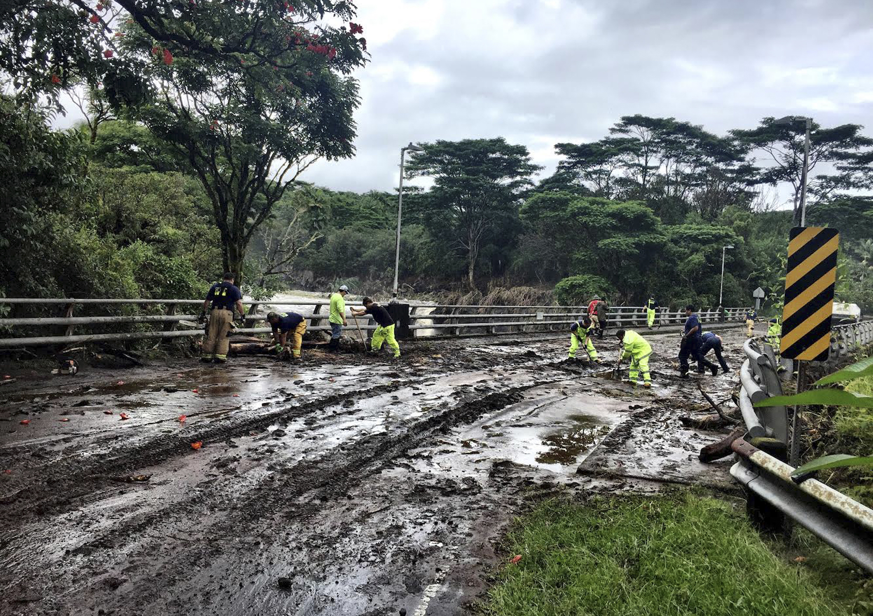 "<div class=""meta image-caption""><div class=""origin-logo origin-image ap""><span>AP</span></div><span class=""caption-text"">In this photo provided by Jessica Henricks, crews work at clearing damage from Hurricane Lane Friday, Aug. 24, 2018, near Hilo, Hawaii. (Jessica Henricks via AP)</span></div>"