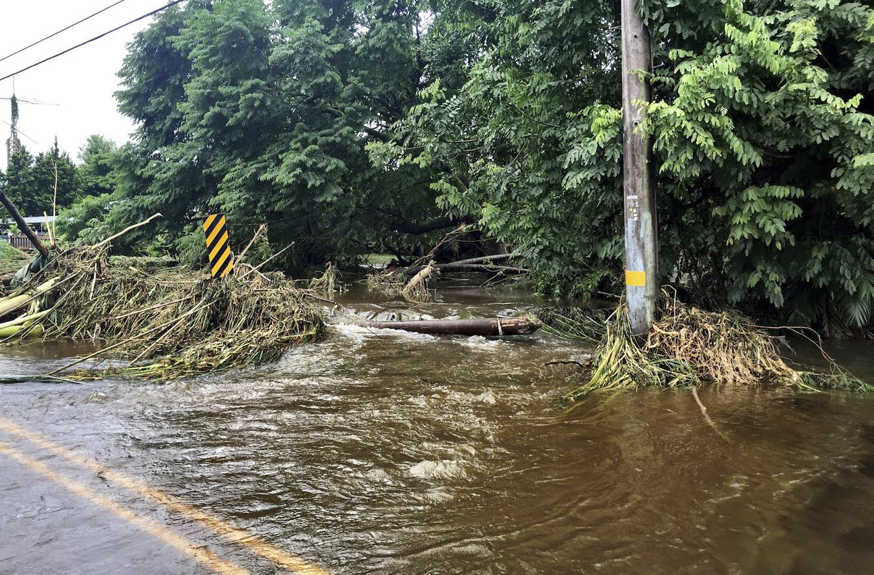 <div class='meta'><div class='origin-logo' data-origin='AP'></div><span class='caption-text' data-credit='Jessica Henricks via AP'>In this photo provided by Jessica Henricks, is flooding and damage from Hurricane Lane Friday, Aug. 24, 2018, near Hilo, Hawaii.</span></div>
