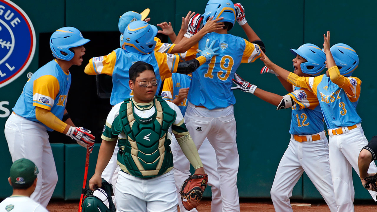 Hawaii teammates celebrate after a home run early in the Little League World Series Championship in South Williamsport, Pa. on Sunday, Aug. 26, 2018.
