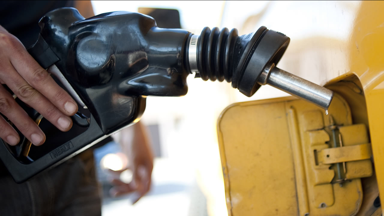A man pumps gas into his dual-tank pickup truck at a 76 gas station in Los Angeles, Friday, Aug. 10, 2012. (AP Photo/Grant Hindsley)