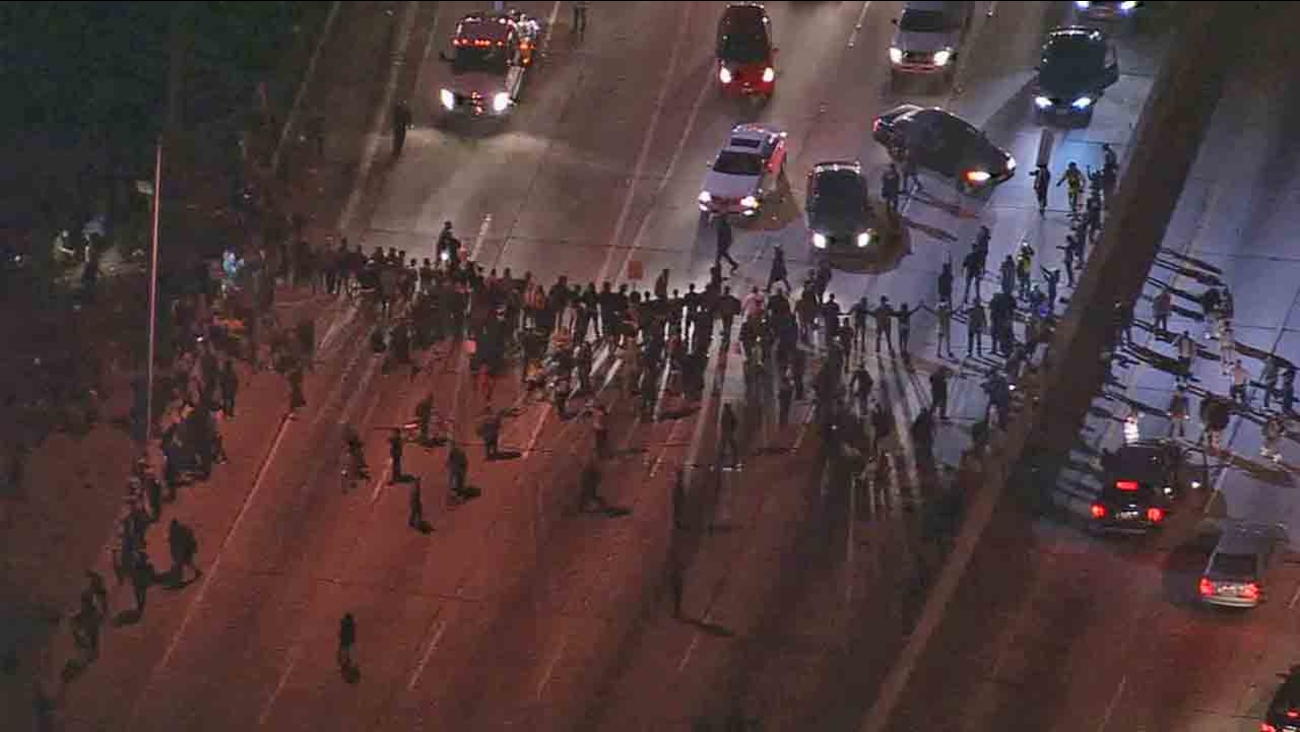 Dozens of people protesting the grand jury's decision in the fatal police shooting of Michael Brown marched onto the 110 Freeway near Pico Boulevard Monday, Nov. 24, 2014.