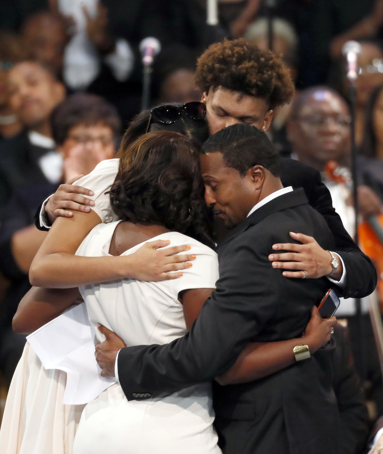 "<div class=""meta image-caption""><div class=""origin-logo origin-image ap""><span>AP</span></div><span class=""caption-text"">Family members hug during the funeral service for Aretha Franklin at Greater Grace Temple, Friday, Aug. 31, 2018, in Detroit. (AP Photo/Paul Sancya)</span></div>"