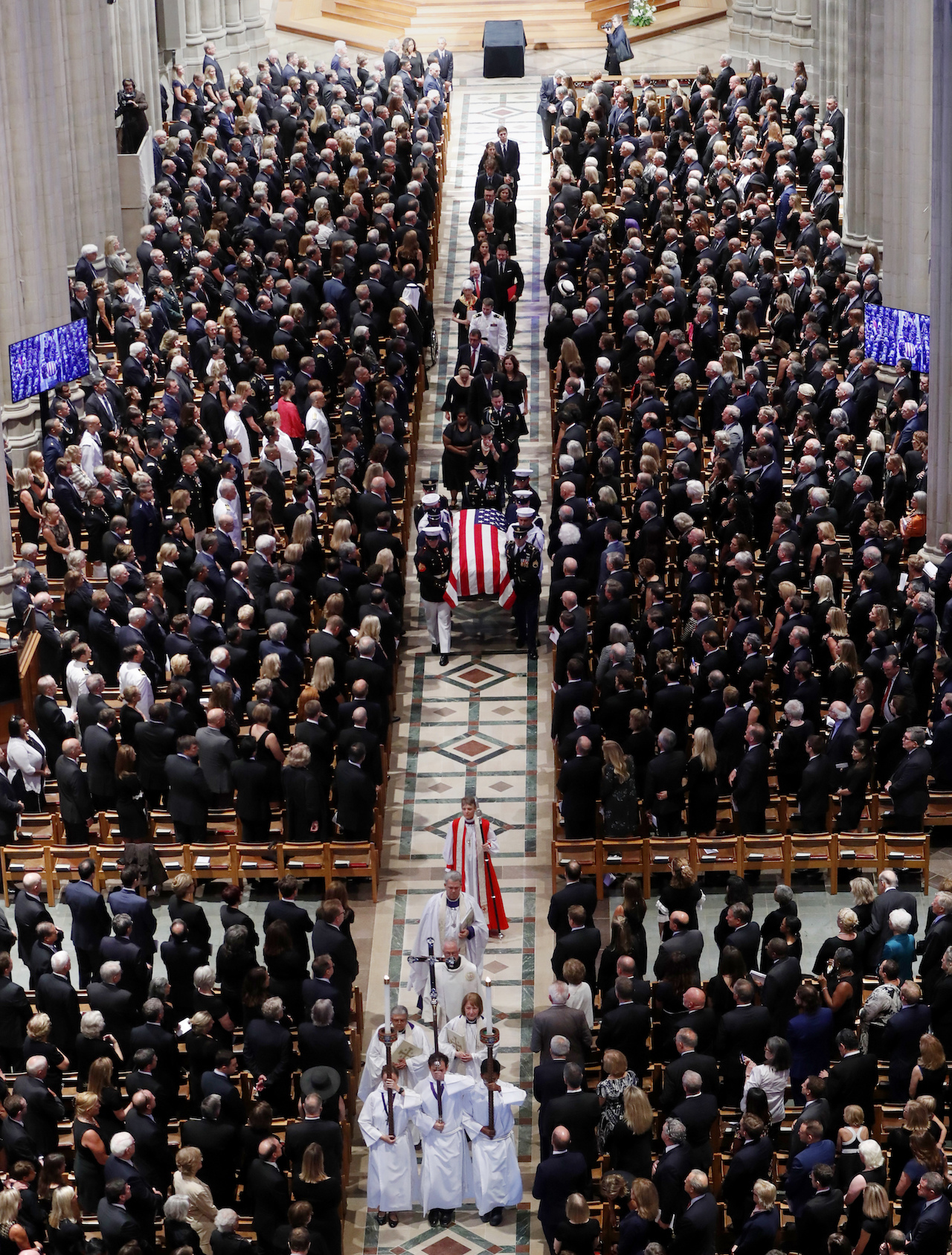 <div class='meta'><div class='origin-logo' data-origin='AP'></div><span class='caption-text' data-credit='AP Photo/Pablo Martinez Monsivais'>at a memorial services for Sen. John McCain, R-Ariz., at Washington Nationals Cathedral in Washington, Saturday, Sept. 1, 2018.</span></div>