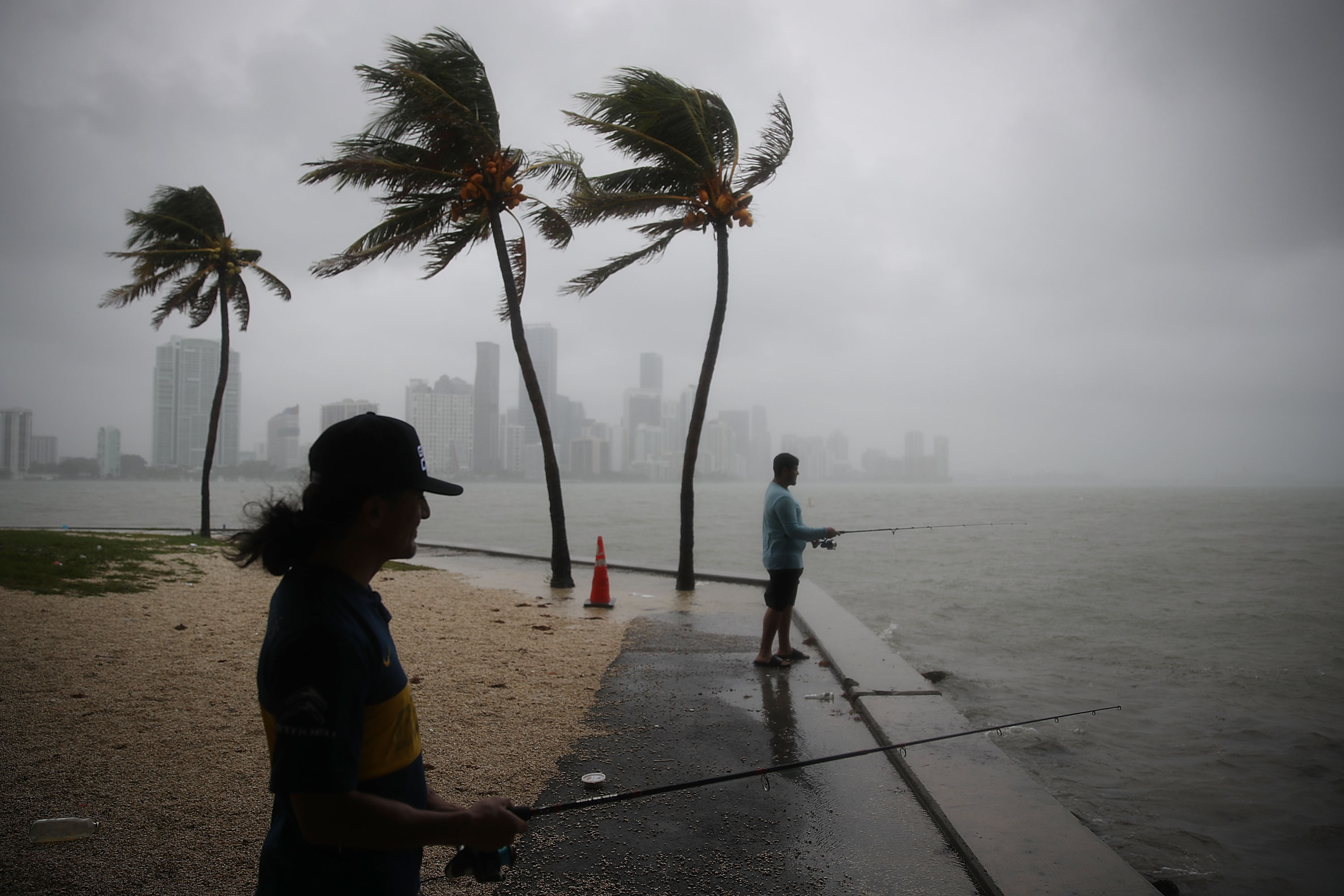 <div class='meta'><div class='origin-logo' data-origin='none'></div><span class='caption-text' data-credit='Joe Raedle/Getty Images'>Walter Augier (L) and Jhon M. fish as rain and wind are whipped up by Tropical Storm Gordon on September 3, 2018 in Miami, Florida.</span></div>