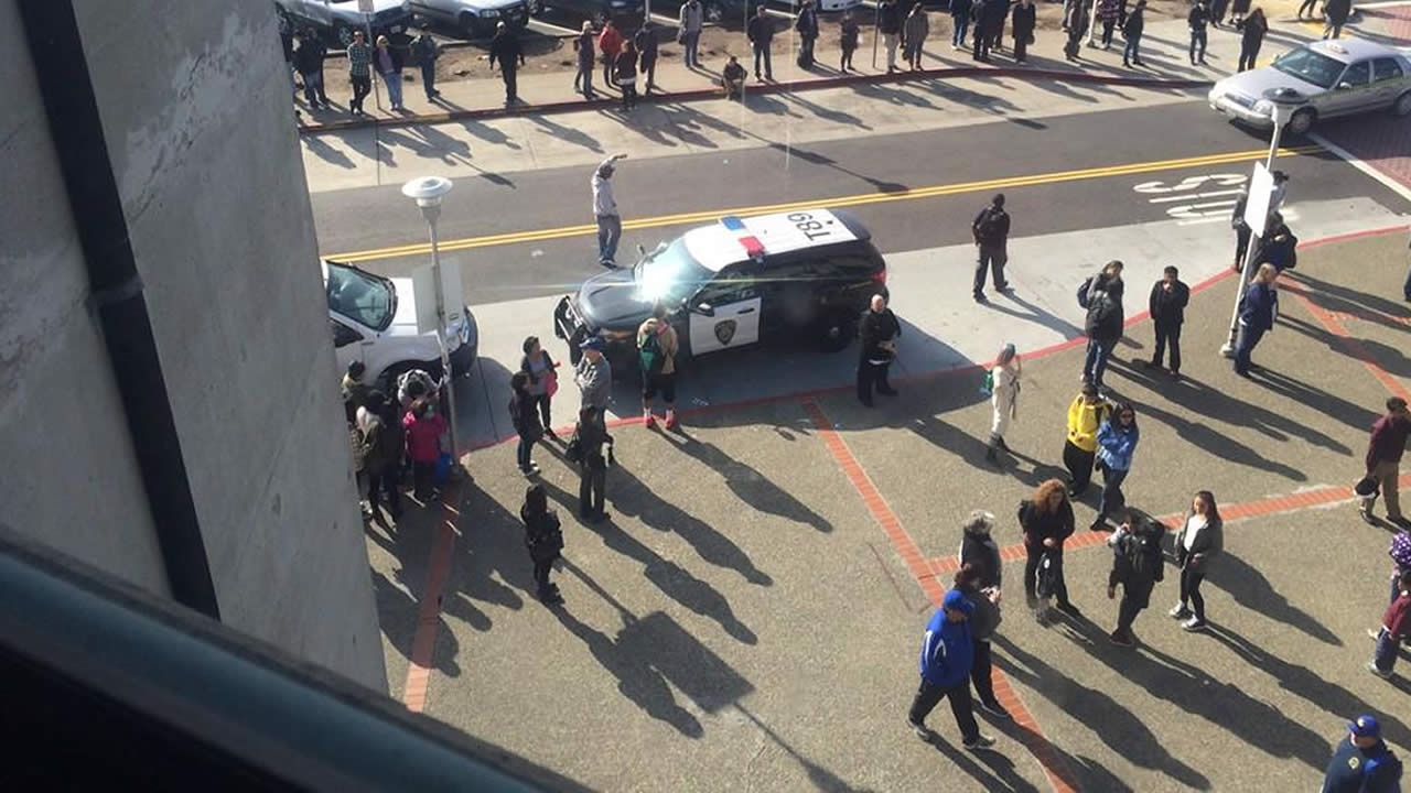 """<div class=""""meta image-caption""""><div class=""""origin-logo origin-image """"><span></span></div><span class=""""caption-text"""">BART PD arrived to remove the demonstrators chained to trains. (@LauraAnthony7)</span></div>"""