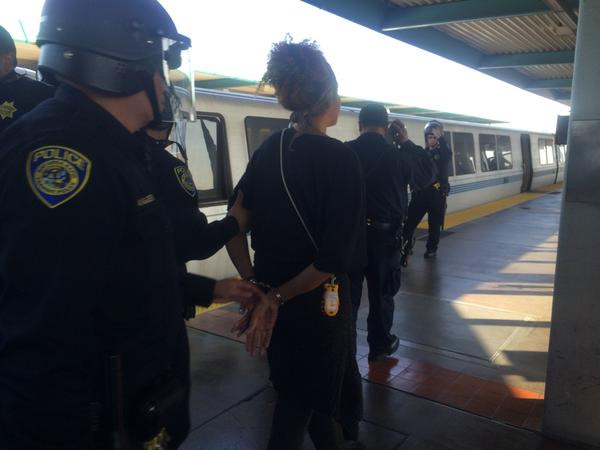 """<div class=""""meta image-caption""""><div class=""""origin-logo origin-image """"><span></span></div><span class=""""caption-text"""">Arrests being made at West Oakland BART. (@LauraAnthony7)</span></div>"""