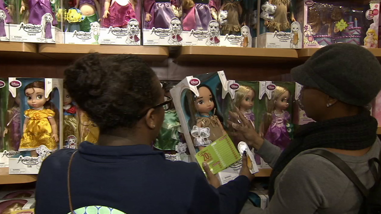 The Steen family picks out toys at the Disney store to donate to ABC7's Spark of Love toy drive.