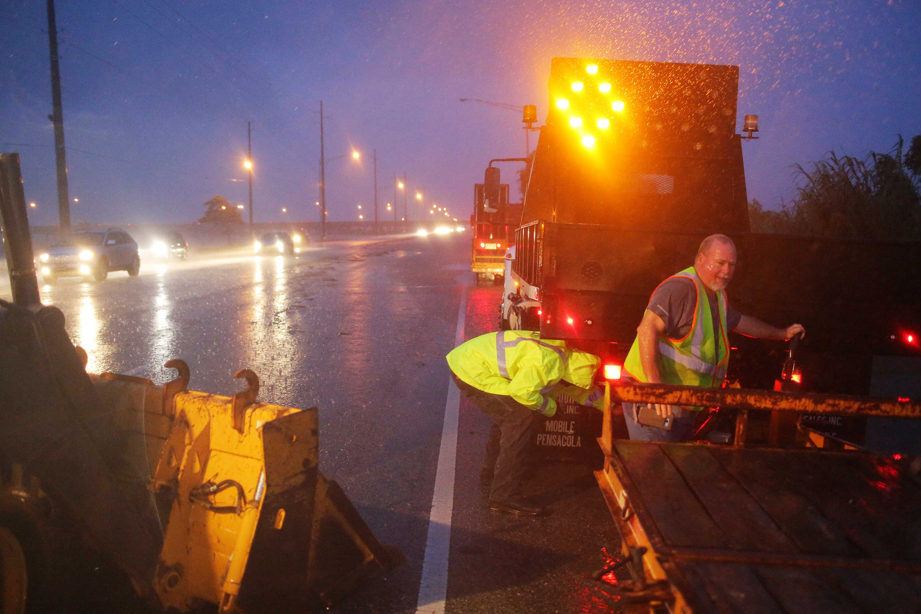 <div class='meta'><div class='origin-logo' data-origin='none'></div><span class='caption-text' data-credit='Dan Anderson/AP Photo'>Crew members with the Alabama Department of Transportation work to block off a flooded part of US Highway 98 while fighting rain from Tropical Storm Gordon on Wednesday, Sept. 5.</span></div>