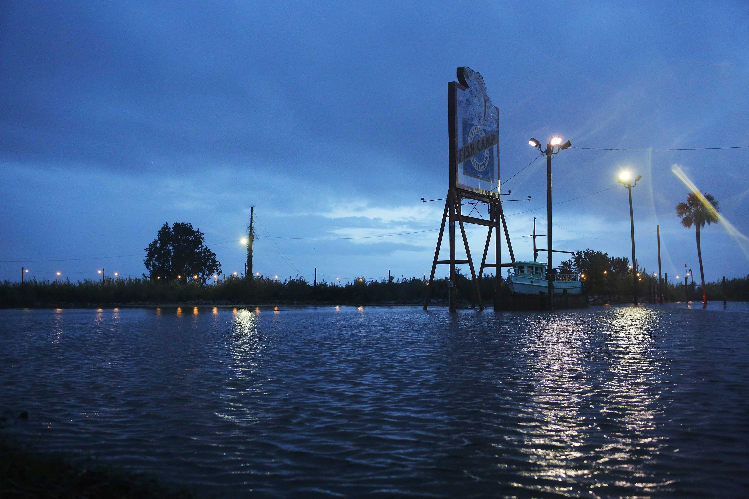 <div class='meta'><div class='origin-logo' data-origin='none'></div><span class='caption-text' data-credit='Dan Anderson/AP Photo'>A flooded parking lot sits near a shutdown portion of US Highway 98 from Tropical Storm Gordon on Wednesday, Sept. 5, 2018, in Spanish Fort, Ala.</span></div>