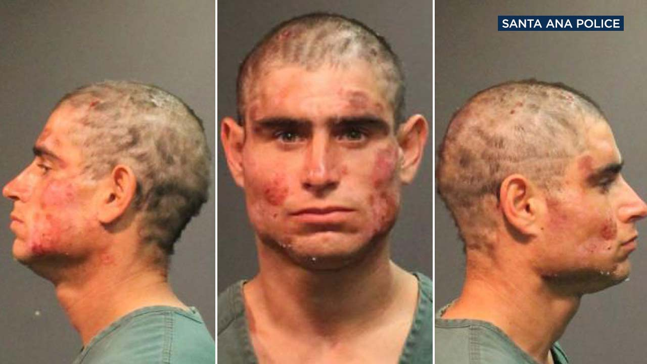 Alan Flores, 28, is seen in booking photos from Santa Ana police.