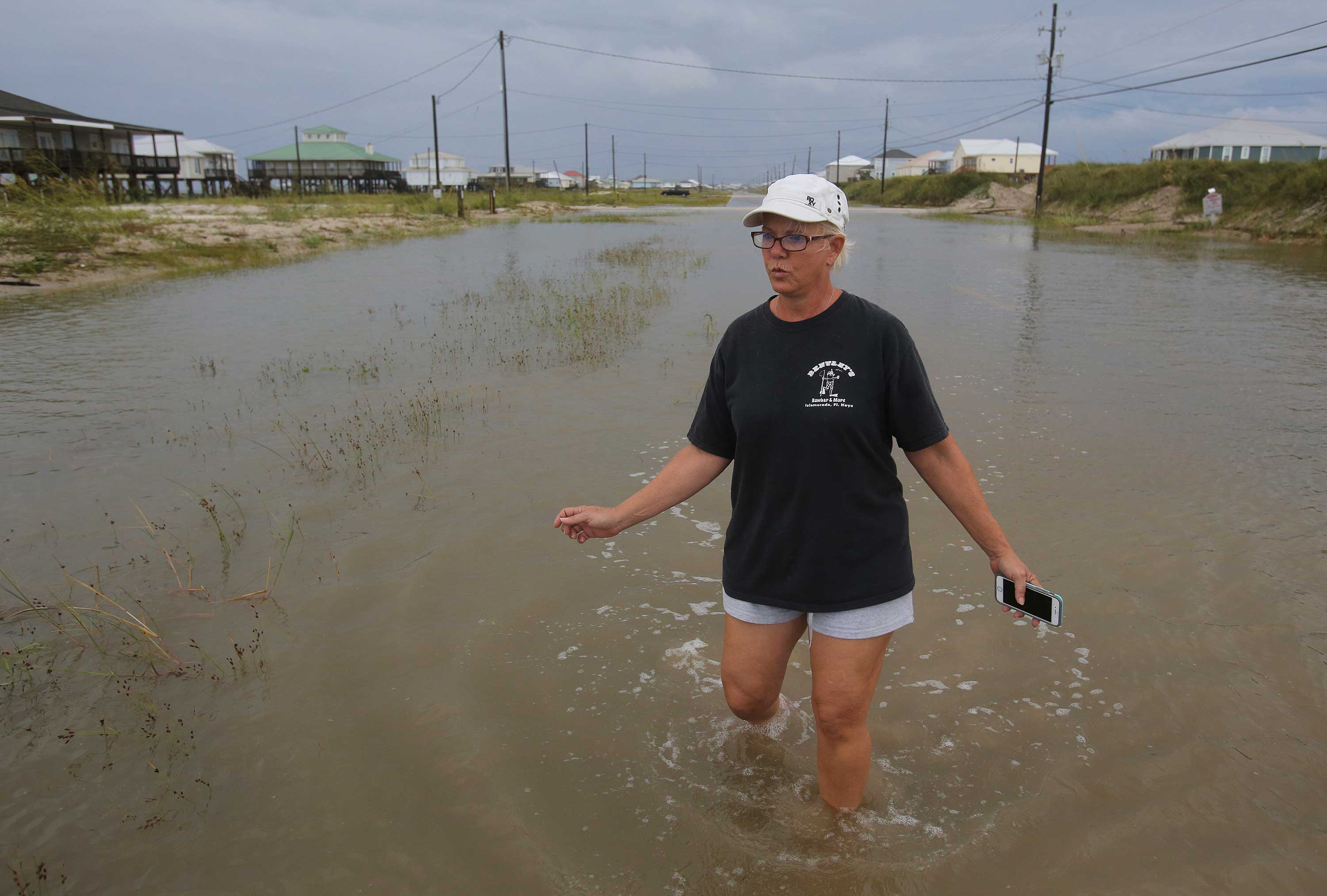 <div class='meta'><div class='origin-logo' data-origin='none'></div><span class='caption-text' data-credit='Dan Anderson/AP Photo'>Susan Jones walks through a flooded road from Tropical Storm Gordon, Wednesday, Sept. 5, 2018, in Dauphin Island, Ala.</span></div>