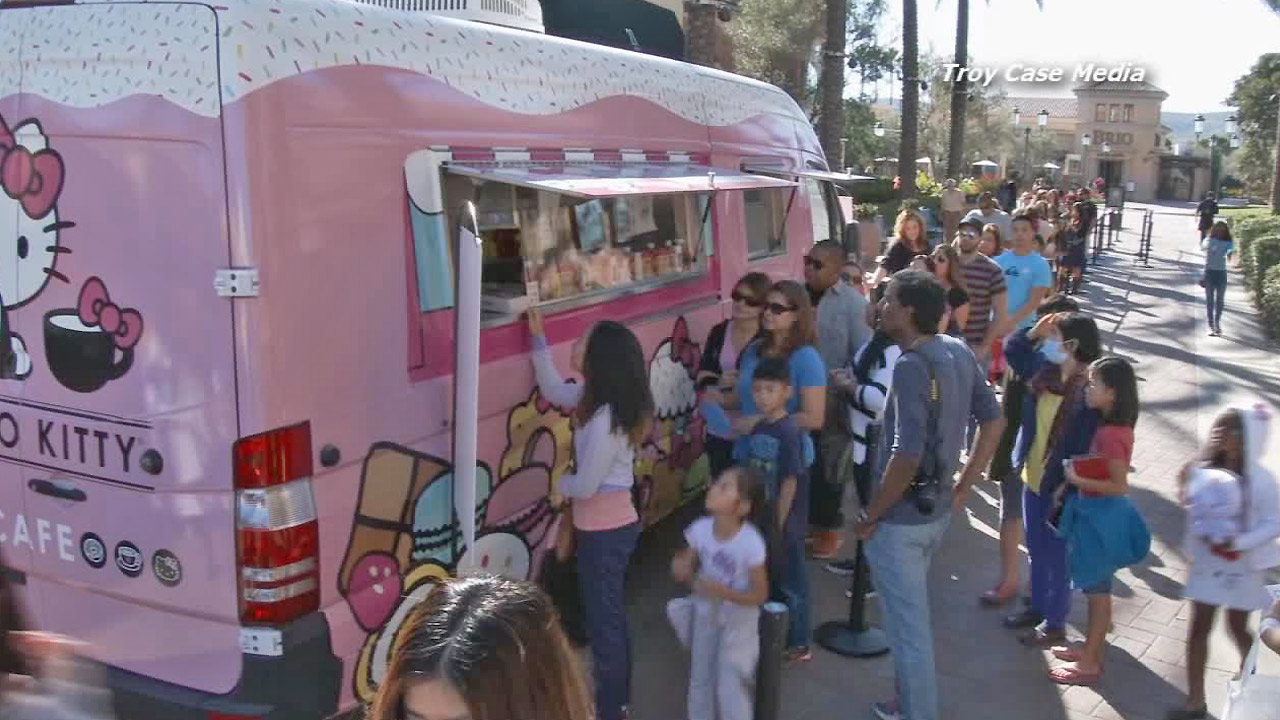 Fans line up in front of the Hello Kitty Cafe truck at the Irvine Spectrum Center on Saturday, Nov. 29, 2014.